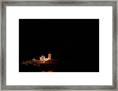 Holiday Lights At Nubble Light Framed Print by Jeff Sinon
