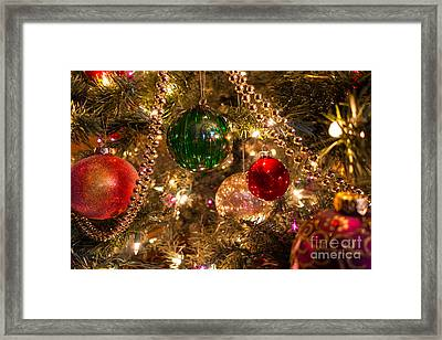 Holiday Ornaments On A Christmas Tree Framed Print by Amy Cicconi