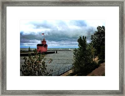 Holland Harbor Light With Big Winds Framed Print by Michelle Calkins
