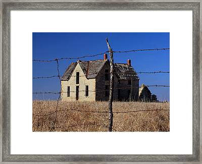 Home Behind The Barbed Wire Framed Print by Christopher McKenzie