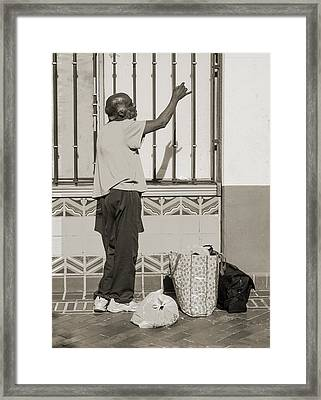 Homeless Man Reaching Up With His Hand Framed Print by Kim M Smith