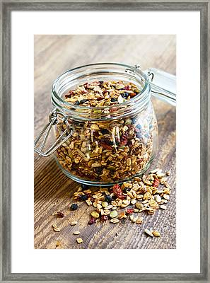 Homemade Granola In Glass Jar Framed Print by Elena Elisseeva