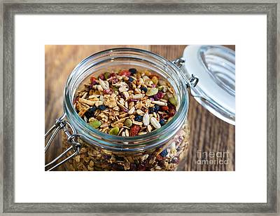 Homemade Granola In Open Jar Framed Print by Elena Elisseeva