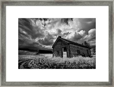 Homestead Under Stormy Sky Framed Print