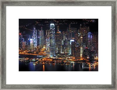Hong Kong's Skyline At Night Framed Print by Lars Ruecker
