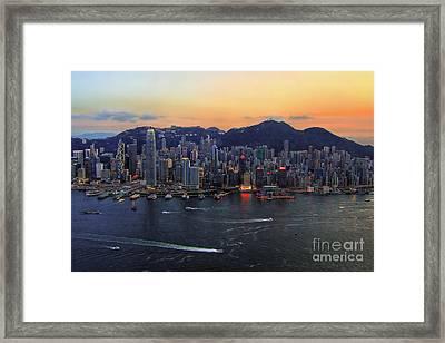 Hong Kong's Skyline During A Beautiful Sunset Framed Print by Lars Ruecker