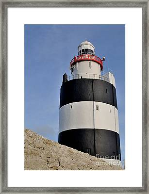 Hook Lighthouse Framed Print by Julian  Walters