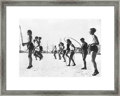 Hoop Jumping Schoolgirls Framed Print by Underwood Archives