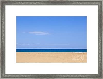 Horizontal Lines Of Sandy Beach Blue Sea And Sky Framed Print