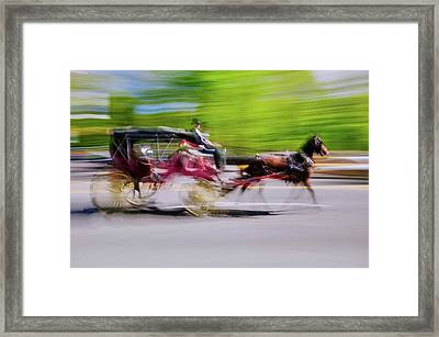 Horse And Carriage Drives In Traffic Framed Print