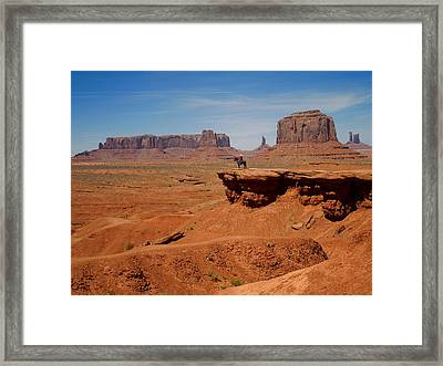 Horse And Rider In Monument Valley Framed Print