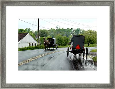 Horse Buggies On A Rainy Day Framed Print by Karen Adams