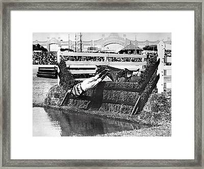 Horse Dumps Rider In Pond Framed Print by Underwood Archives
