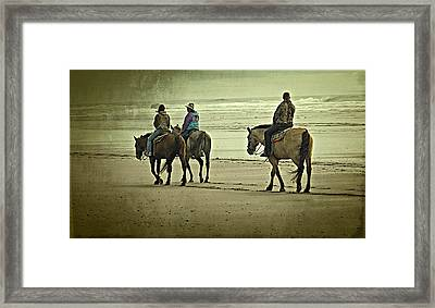 Framed Print featuring the photograph Horseback Riding On The Beach by Thom Zehrfeld