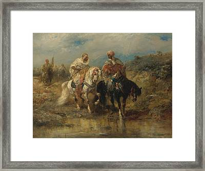 Horsemen At A Watering Hole Framed Print by Celestial Images