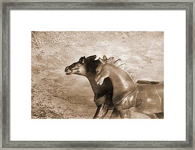 Horses Trapped In A Dream Framed Print by Jeff  Gettis