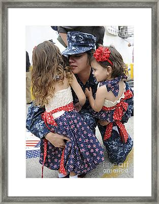 Hospital Corpsman Hugs Her Daughters Framed Print by Stocktrek Images