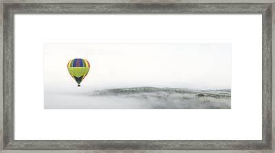 Hot Air Ballooning Above Foggy Hills Framed Print