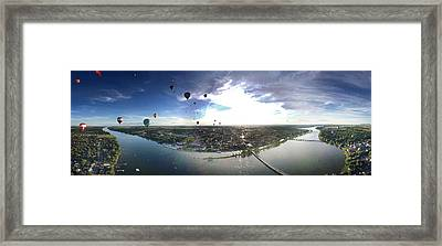 Hot Air Balloons Flying Over A River Framed Print
