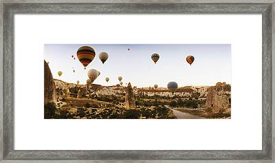 Hot Air Balloons Over Landscape Framed Print