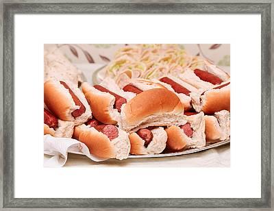 Hot Dogs Framed Print by Tom Gowanlock