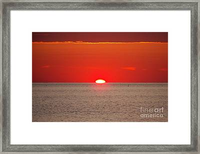 Hot Sun Seems To Melt Into The Sea Framed Print by Eunice Miller