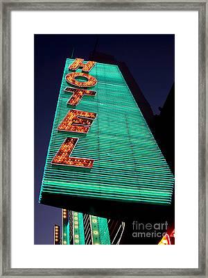 Hotel Lights Framed Print by John Rizzuto