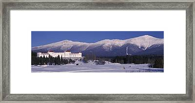 Hotel Near Snow Covered Mountains, Mt Framed Print