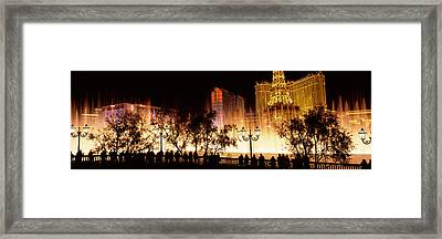Hotels In A City Lit Up At Night, The Framed Print by Panoramic Images
