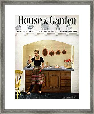House And Garden Featuring A Woman Cooking Framed Print