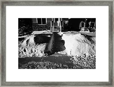 house with path cleared of snow leading to front porch Saskatoon Saskatchewan  Framed Print by Joe Fox