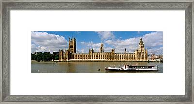 Houses Of Parliament, Water And Boat Framed Print