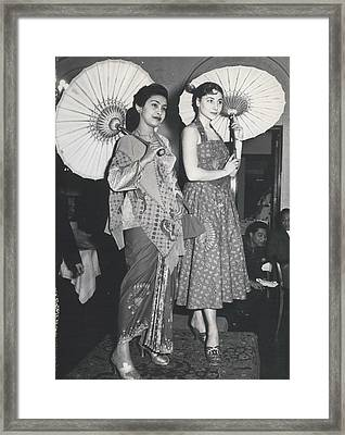 How Do You Like These Batik-clothes ? Framed Print by Retro Images Archive