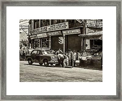 How To Change A Tire Sepia Framed Print by Steve Harrington