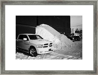 huge pile of snow cleared from parking lot in Saskatoon Saskatchewan Canada Framed Print by Joe Fox