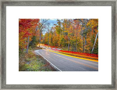 Hugging The Curves Framed Print by Adam Romanowicz