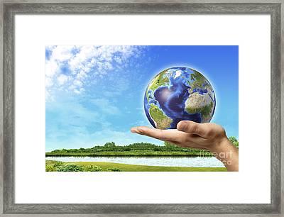 Human Hand Holding Earth Globe Framed Print by Leonello Calvetti