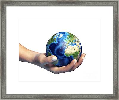 Human Hand Holding Planet Earth Framed Print by Leonello Calvetti