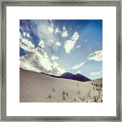 Sand And Clouds Framed Print
