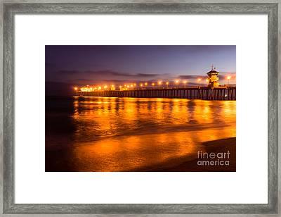 Huntington Beach Pier At Night Framed Print by Paul Velgos