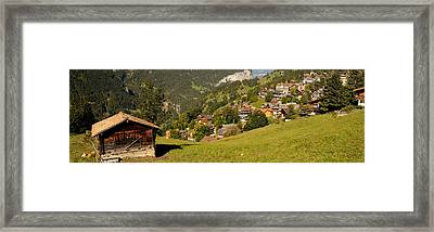 Hut With Village In The Background Framed Print