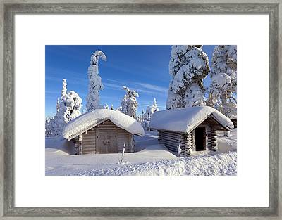 Huts In Forest After Heavy Snowfall Framed Print