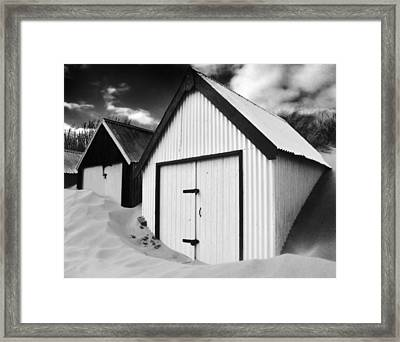 Huts In Sand Framed Print
