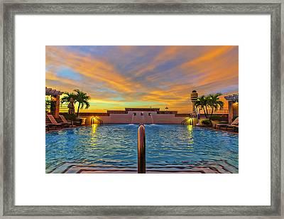 Hyatt Morning Pool Framed Print by Bill Tiepelman