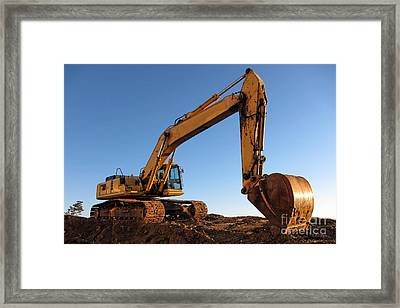 Hydraulic Excavator Framed Print by Olivier Le Queinec