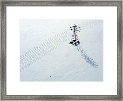 Hydro Lines Over A Frozen Ottawa River. Framed Print