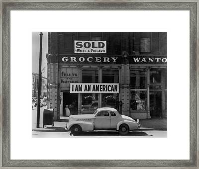 I Am An American Sign On A Store Front Framed Print by Everett