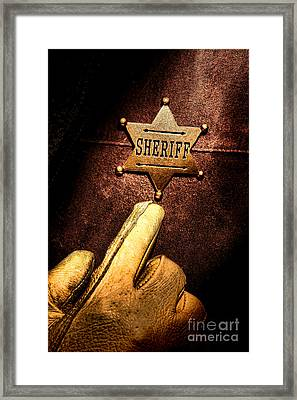 I Am The Law Framed Print by Olivier Le Queinec