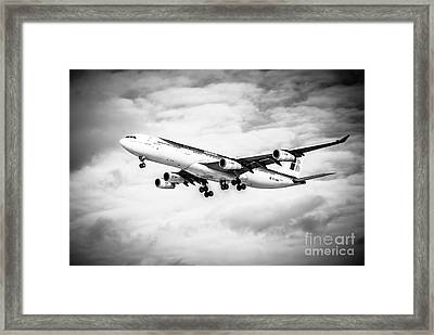 Iberia Airlines Airbus A340 Airplane In Black And White Framed Print by Paul Velgos