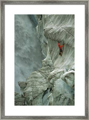 Ice Climber In Fox Glacier Crevasse Framed Print by Colin Monteath